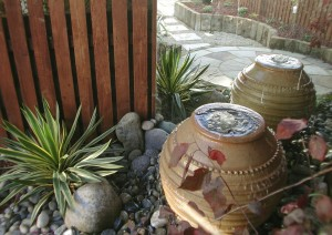 Terracotta urn waterfeature with mirror