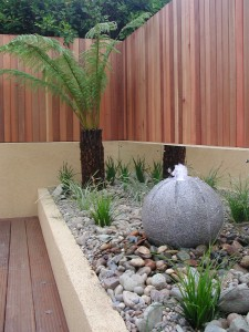 Granite ball waterfeature in raised bed