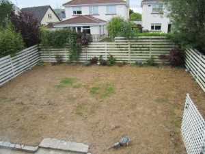 Sloping lawn and fencing