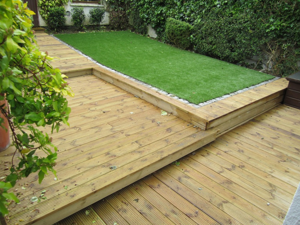 Deck and synthetic grass lawn