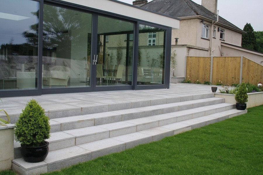 Spacious silver granite steps to double up as seating