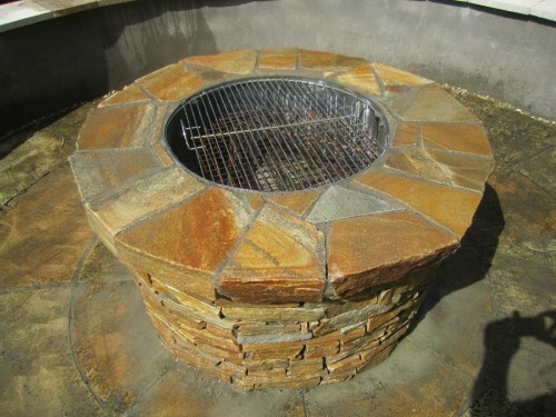 fire pit and stainless steel weber grill