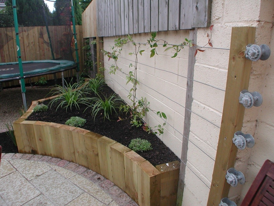 Raised sleeper bed and bull wire trellising