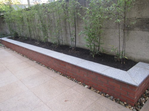 Red brick raised bed/seat