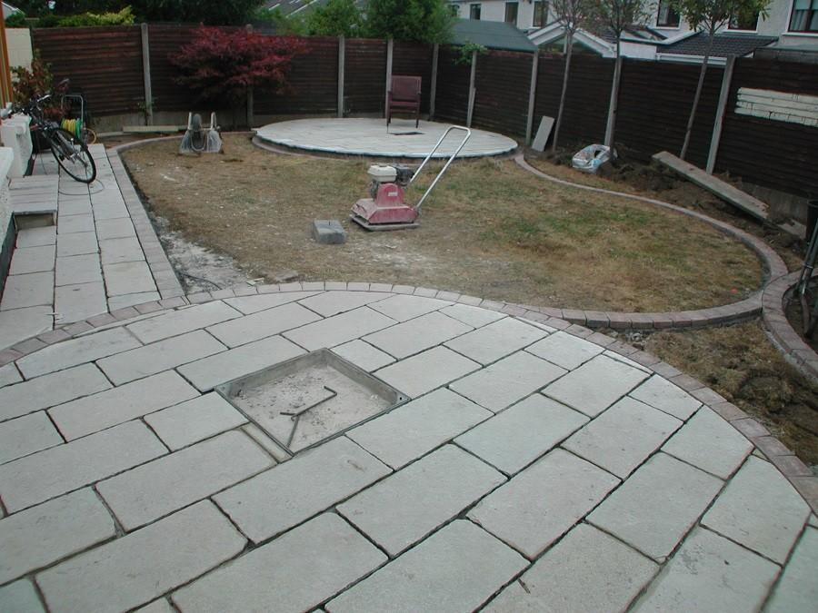 Limestone circle & recessed manhole