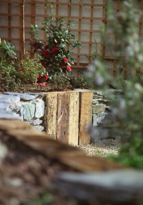 Railway sleepers contrasting with black limestone